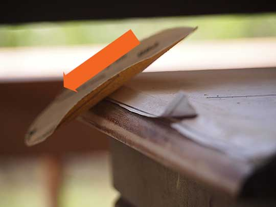 Use sandpaper to easily remove the excess paper around the edges of the table and to give it an imperfect rough edge.